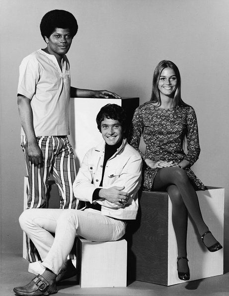 Promotional studio portrait of Clarence Williams III, Michael Cole, Peggy Lipton for the television series,