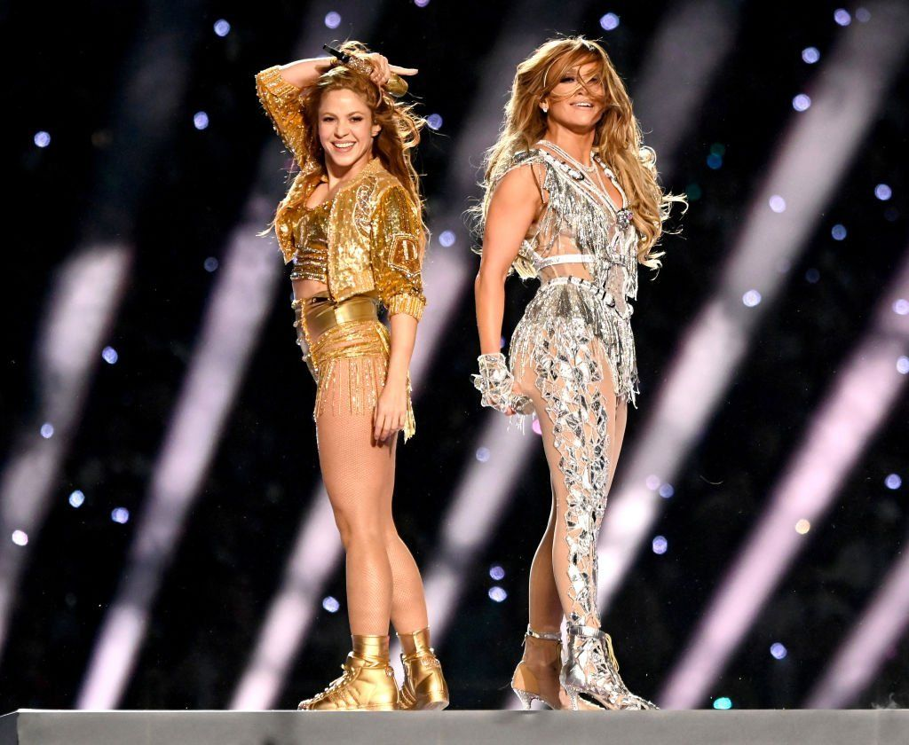 Shakira and Jennifer Lopez stand back to back as they perform onstage during the Pepsi Super Bowl LIV Halftime Show, at Hard Rock Stadium, on February 02, 2020, in Miami, Florida | Source: Getty Images (Photo by Kevin Mazur/WireImage)
