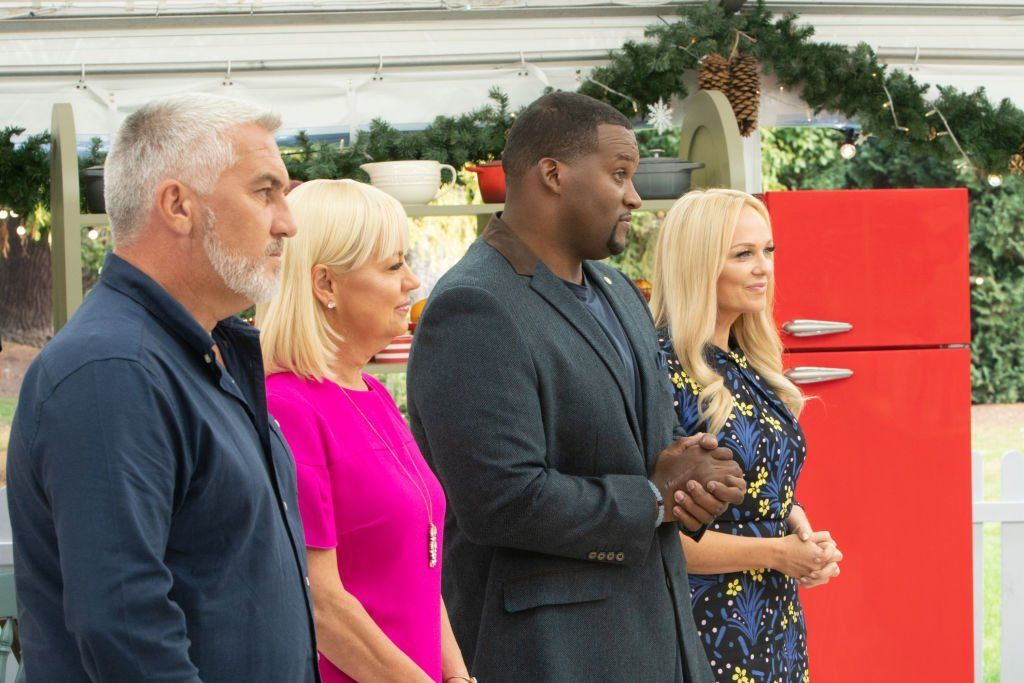 "Paul Hollywood, Sherry Yard, Anthony ""Spice"" Adams and Emma Bunton stand before contestants on"